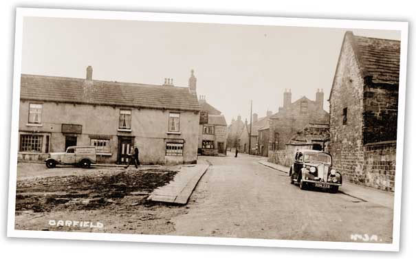 The row of houses in the fore of this shot of Darfield has now been demolished, but the one just visible behind it can still be seen today and houses the Maurice Dobson Heritage Centre.